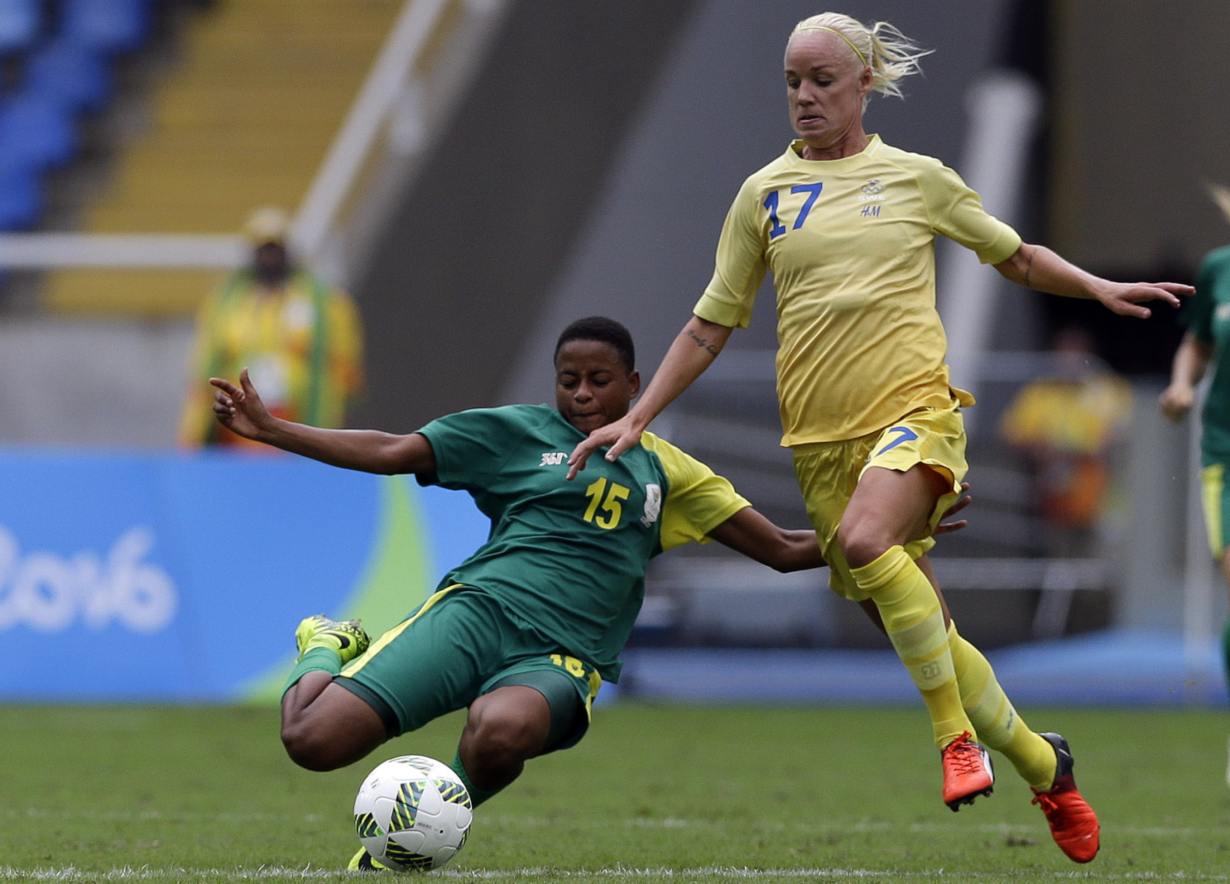 Sweden's Caroline Seger, right, and South Africa's Refiloe Jane fight for the ball during the opening match of the Women's Olympic Football Tournament between Sweden and South Africa at the Rio Olympic Stadium in Rio de Janeiro, Brazil, Wednesday, Aug. 3, 2016. (AP Photo/Leo Correa)