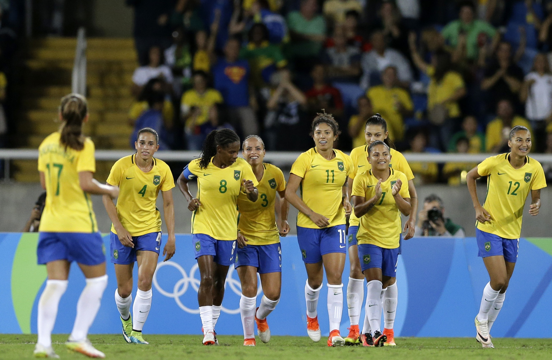 Brazil's Cristiane ( 11 ), celebrates with tam mates after scoring her team's third goal during a Group E match of the women's Olympic football tournament between Brazil and China at the Rio Olympic Stadium in Rio de Janeiro, Brazil, Wednesday, Aug. 3, 2016.(AP Photo/Leo Correa)