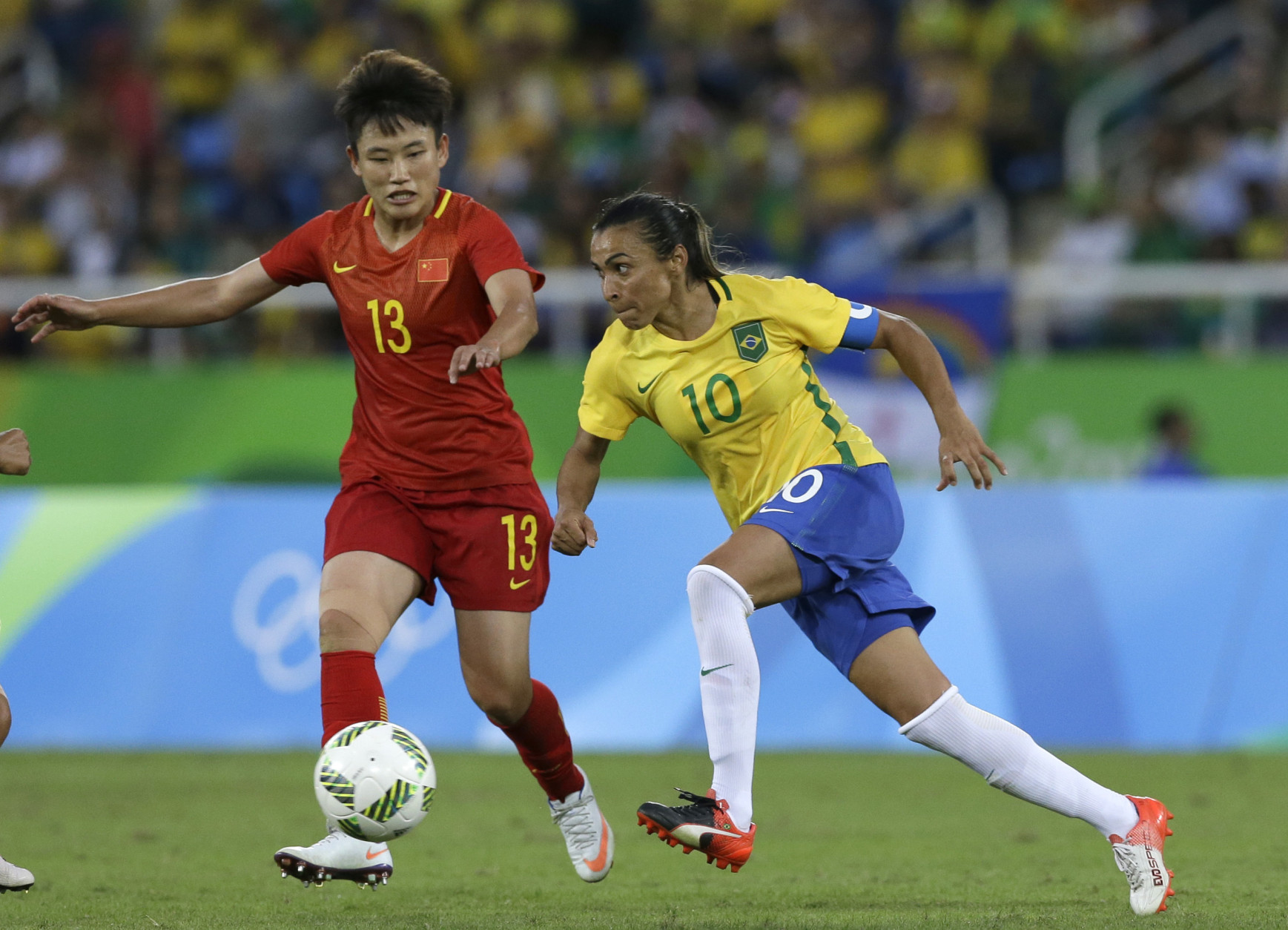 Brazil's Marta controls the ball past China's Pang Fengyue during a Group E match of the Women's Olympic Football Tournament between Brazil and China at the Rio Olympic Stadium in Rio de Janeiro, Brazil, Wednesday, Aug. 3, 2016.(AP Photo/Leo Correa)