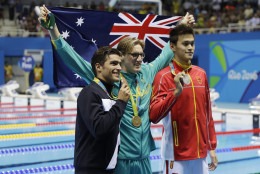 Winner Australia's Mack Horton, center, second placed Italy's Gabriele Detti, left, and third placed China's Sun Yang hold their medals after the men's 400-meter freestyle during the swimming competitions at the 2016 Summer Olympics, Saturday, Aug. 6, 2016, in Rio de Janeiro, Brazil. (AP Photo/Matt Slocum)