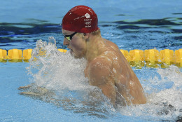 Britain's Adam Peaty competes as he sets a new world record in a men's 100-meter breaststroke heat during the swimming competitions at the 2016 Summer Olympics, Saturday, Aug. 6, 2016, in Rio de Janeiro, Brazil. (AP Photo/Martin Meissner)