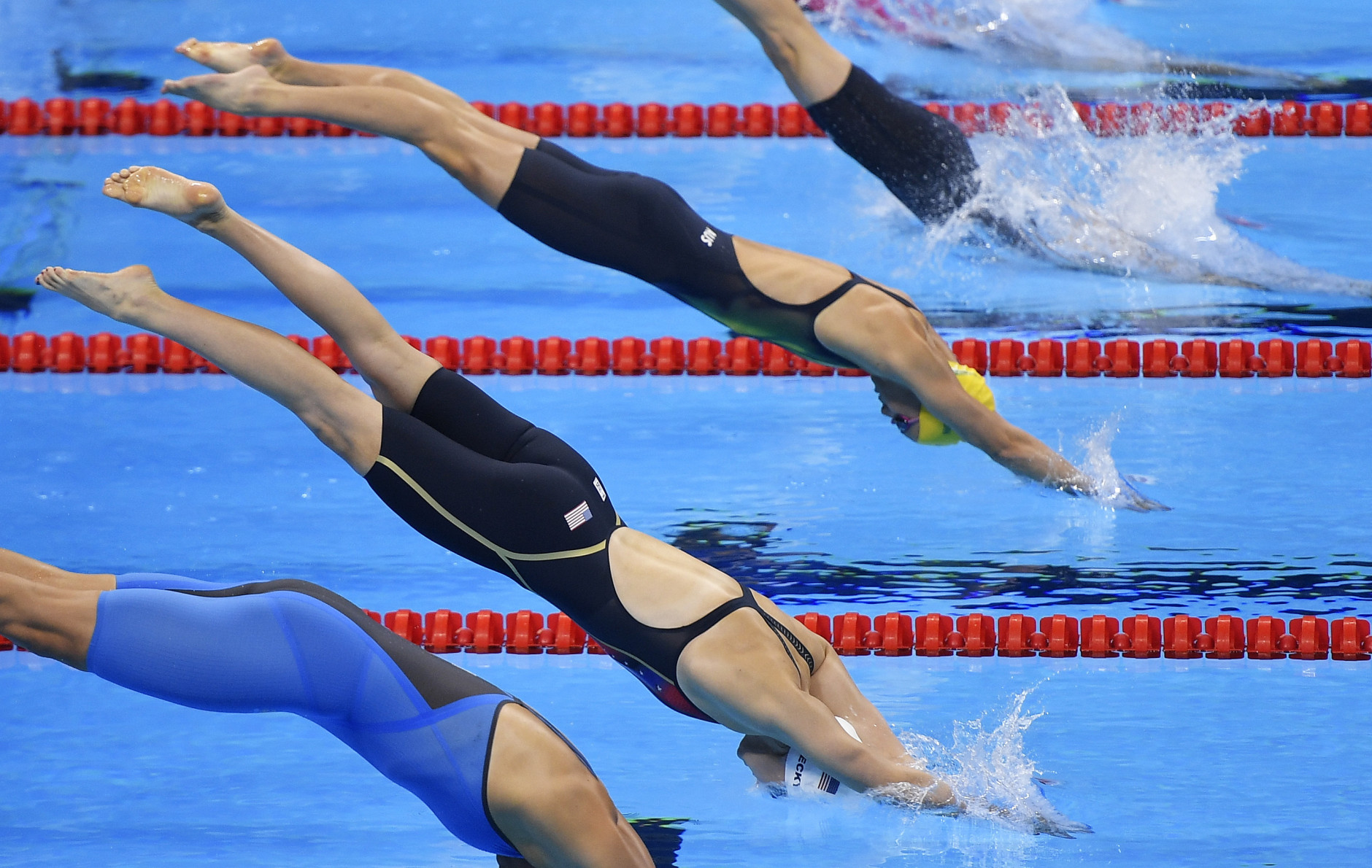 United States' Katie Ledecky, second from front, starts a women's 200-meter freestyle heat during the swimming competitions at the 2016 Summer Olympics, Monday, Aug. 8, 2016, in Rio de Janeiro, Brazil. (AP Photo/Martin Meissner)