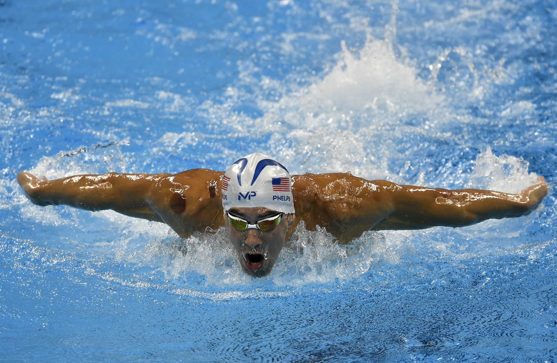 United States' Michael Phelps competes in a men's 200-meter butterfly heat during the swimming competitions at the 2016 Summer Olympics, Monday, Aug. 8, 2016, in Rio de Janeiro, Brazil. (AP Photo/Martin Meissner)