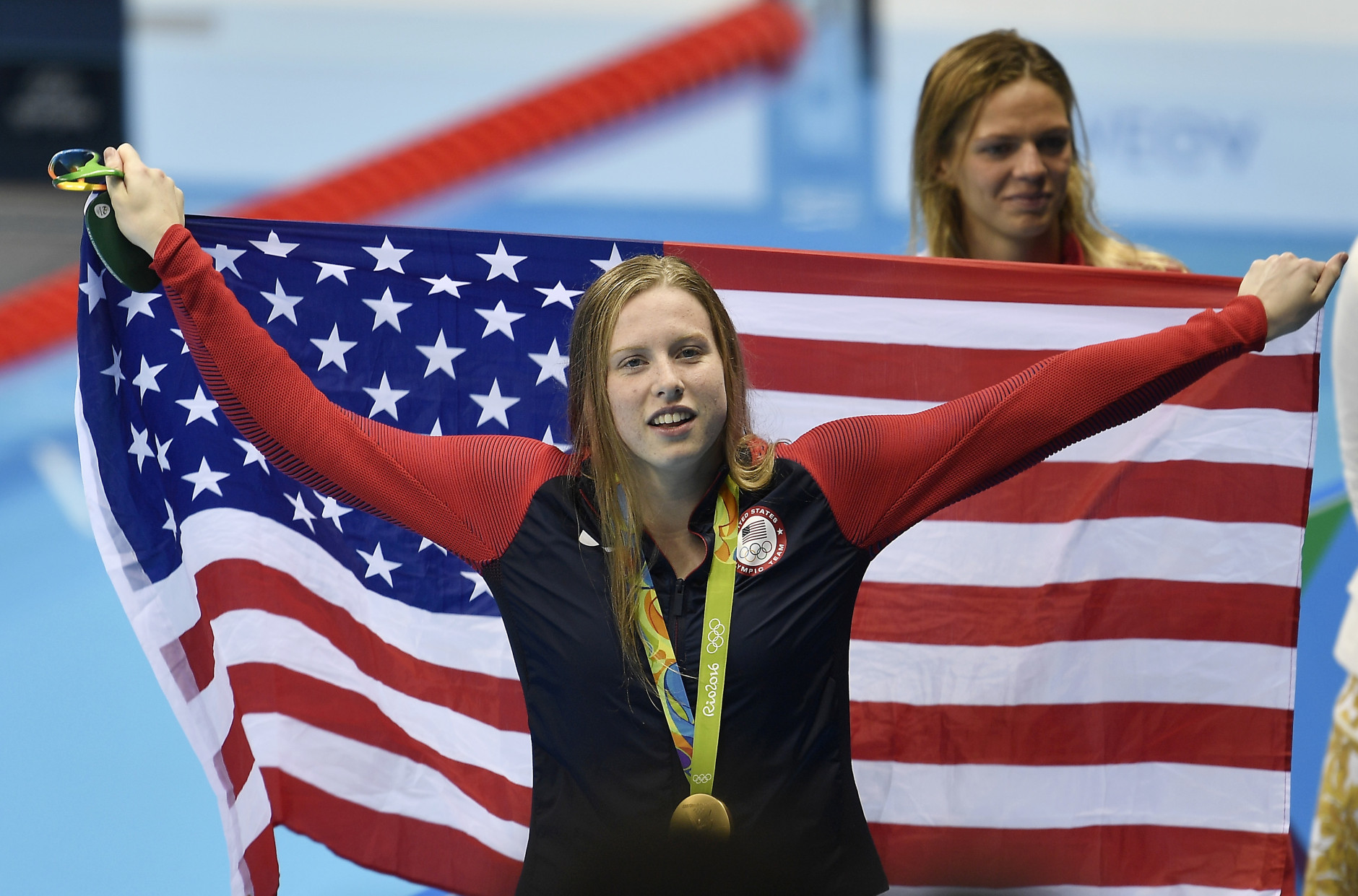 United States' gold medal winner Lilly King celebrates with her country's flag after the women's 100-meter breaststroke final during the swimming competitions at the 2016 Summer Olympics, Tuesday, Aug. 9, 2016, in Rio de Janeiro, Brazil. (AP Photo/Martin Meissner)