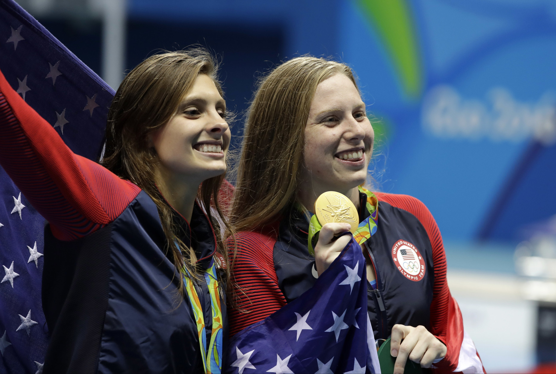 Winner United States' Lilly King, right, and third place United States' Katie Meili celebrate after the women's 100-meter breaststroke during the swimming competitions at the 2016 Summer Olympics, Tuesday, Aug. 9, 2016, in Rio de Janeiro, Brazil. (AP Photo/Matt Slocum)
