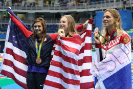 Winner United States' Lilly King, center, second placed Russia's Yulia Efimova, right, and third placed United States' Katie Meili celebrate with their medals after the women's 100-meter breaststroke during the swimming competitions at the 2016 Summer Olympics, Tuesday, Aug. 9, 2016, in Rio de Janeiro, Brazil. (AP Photo/Lee Jin-man)