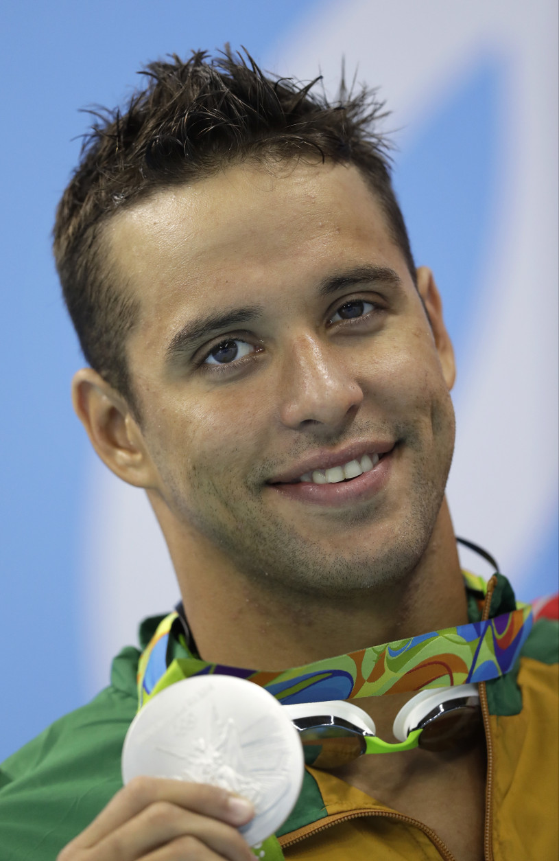 South Africa's Chad Le Clos shows off his silver medal during the medal ceremony for the men's 200-meter freestyle final during the swimming competitions at the 2016 Summer Olympics, Monday, Aug. 8, 2016, in Rio de Janeiro, Brazil. (AP Photo/Michael Sohn)