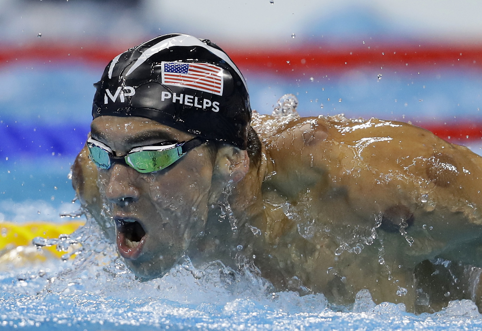 United States' gold medal winner Michael Phelps swims in the men's 200-meter butterfly final during the swimming competitions at the 2016 Summer Olympics, Tuesday, Aug. 9, 2016, in Rio de Janeiro, Brazil. (AP Photo/Michael Sohn)