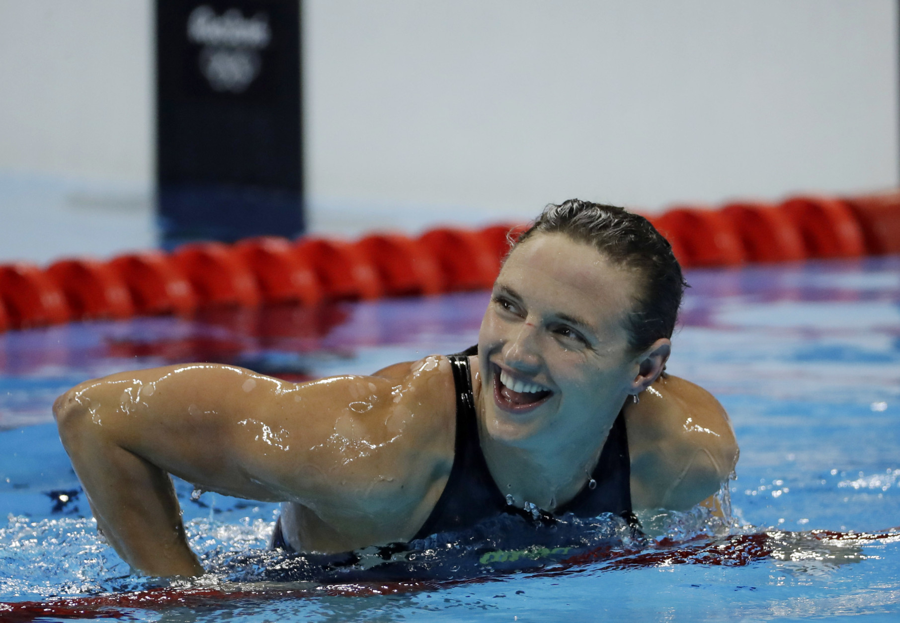 Hungary's Katinka Hosszu smiles after breaking the world record and winning the gold medal in the women's 400-meter individual medley during the swimming competitions at the 2016 Summer Olympics, Saturday, Aug. 6, 2016, in Rio de Janeiro, Brazil. (AP Photo/Matt Slocum)