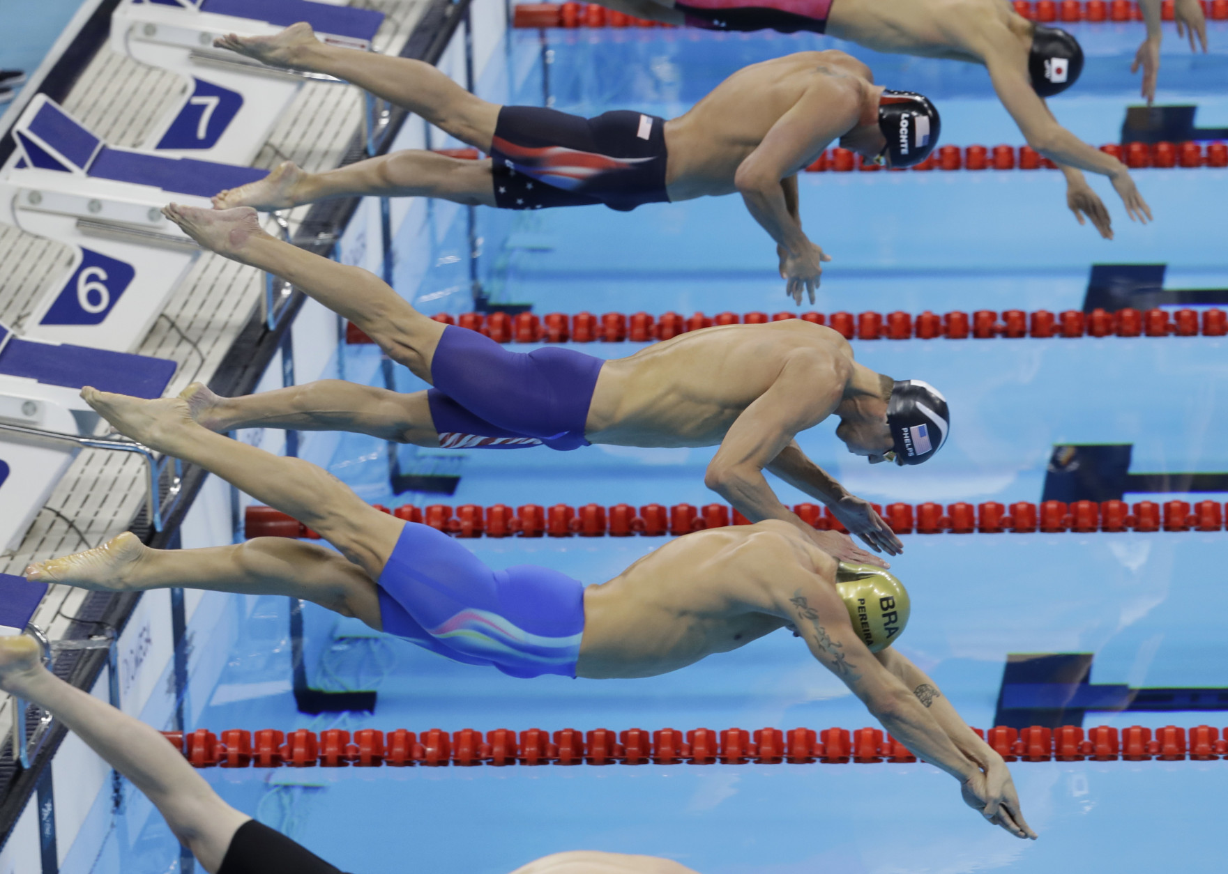 Brazil's Thiago Pereira, United States' Michael Phelps, center, and United States' Ryan Lochte, top, compete in the final of the men's 200-meter individual medley during the swimming competitions at the 2016 Summer Olympics, Thursday, Aug. 11, 2016, in Rio de Janeiro, Brazil. (AP Photo/Natacha Pisarenko)