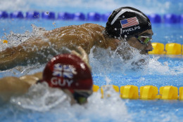 United States' Michael Phelps and Britain's James Guy compete in the men's 4 x 100-meter medley relay final during the swimming competitions at the 2016 Summer Olympics, Saturday, Aug. 13, 2016, in Rio de Janeiro, Brazil. (AP Photo/Rebecca Blackwell)