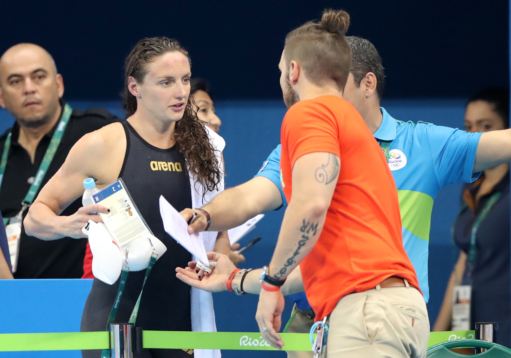 Hungary's Katinka Hosszu and her husband and coach Shane Tusup after a heat of the women's 100-meter backstroke during the swimming competitions at the 2016 Summer Olympics, Sunday, Aug. 7, 2016, in Rio de Janeiro, Brazil. (AP Photo/Lee Jin-man)