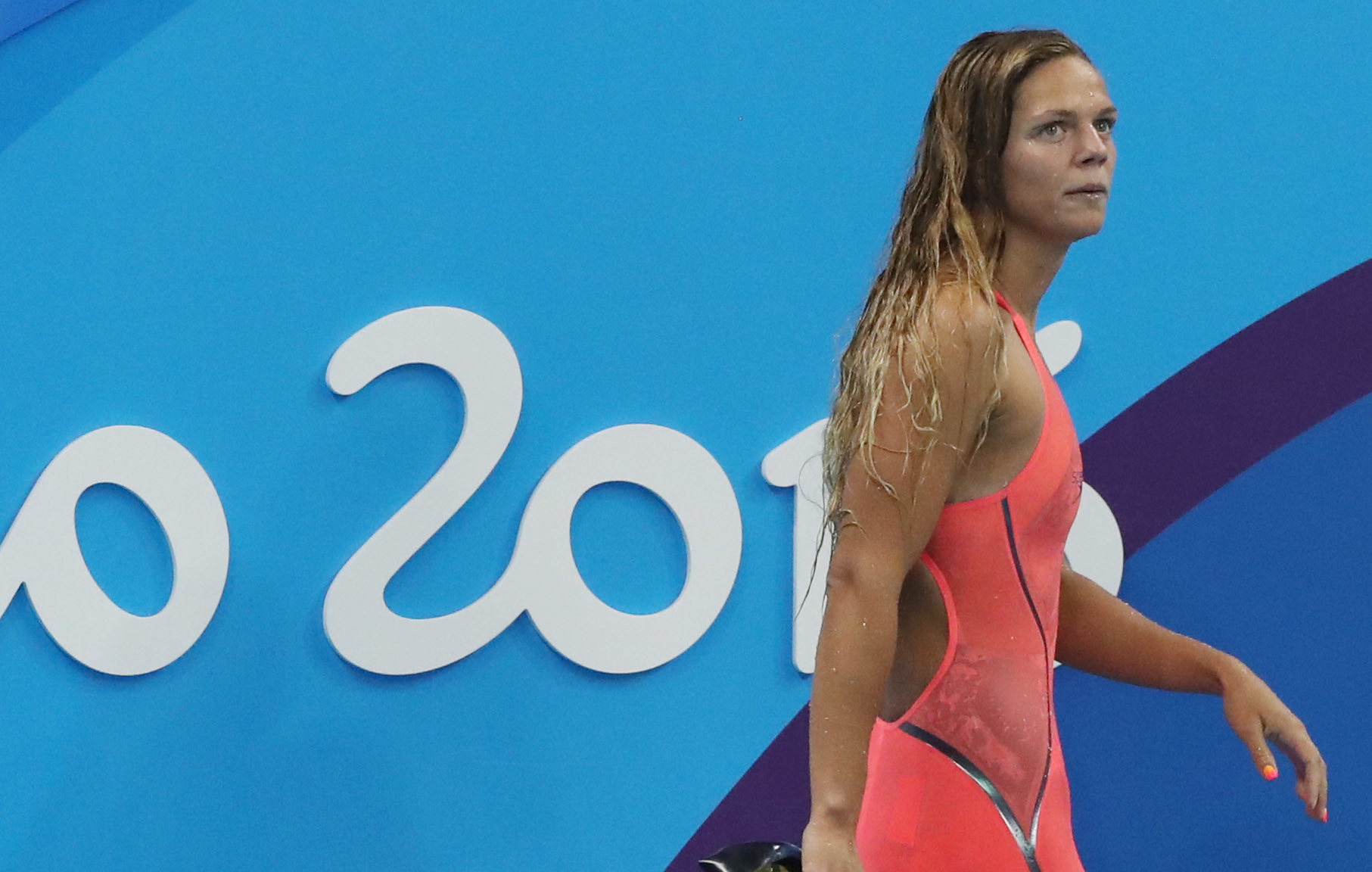 Russia's Yulia Efimova leaves the pool area after competing in a heat of the women's 100-meter breaststroke during the swimming competitions at the 2016 Summer Olympics, Sunday, Aug. 7, 2016, in Rio de Janeiro, Brazil. (AP Photo/Lee Jin-man)