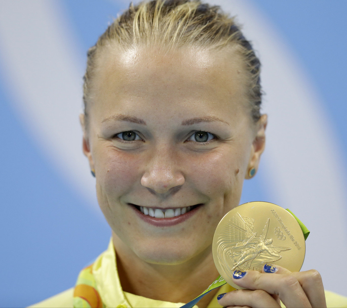 Sweden's Sarah Sjostrom shows off her gold medal, after setting a new world record, during the medal ceremony for the women's 100-meter butterfly final during the swimming competitions at the 2016 Summer Olympics, Sunday, Aug. 7, 2016, in Rio de Janeiro, Brazil. (AP Photo/Michael Sohn)s