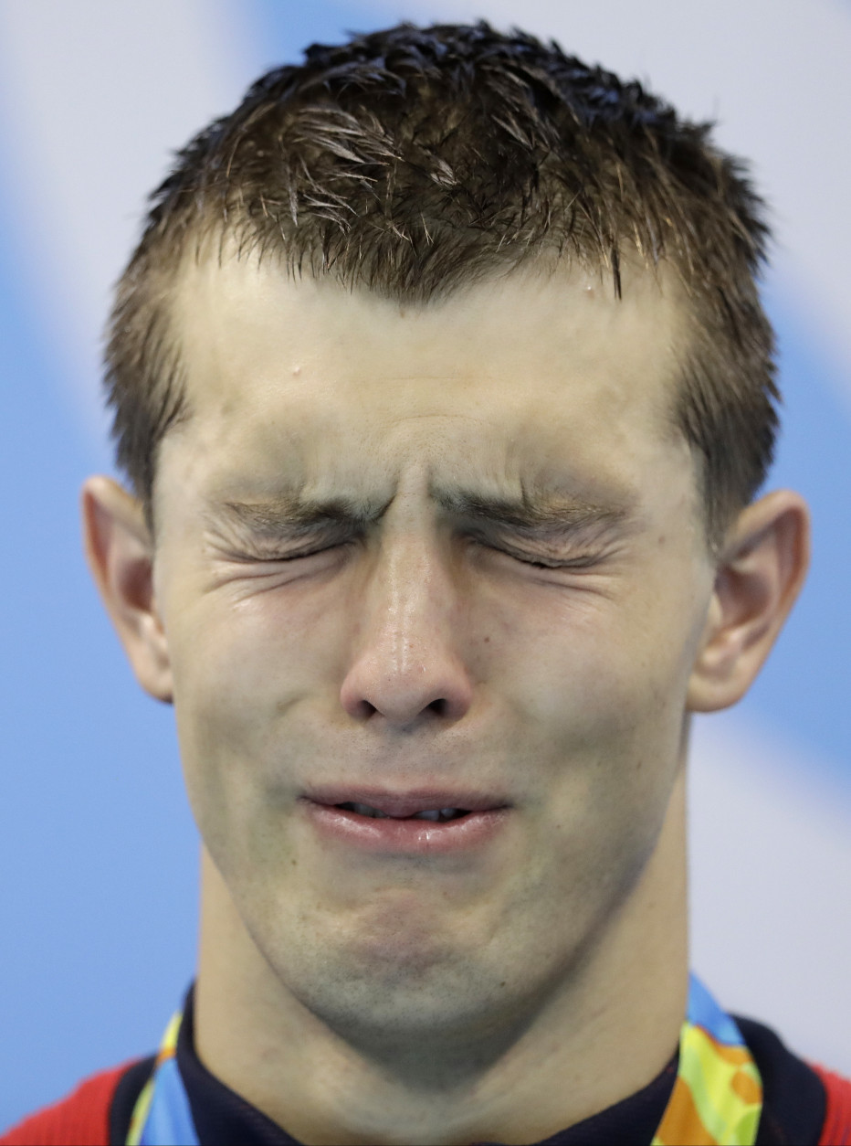 United States' gold medal winner Ryan Held cries during the medal ceremony for the men's 4x100-meter freestyle relay final at the swimming competitions at the 2016 Summer Olympics, Monday, Aug. 8, 2016, in Rio de Janeiro, Brazil. (AP Photo/Michael Sohn)