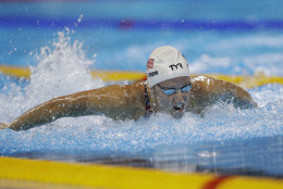 United States' Dana Vollmer competes in a women's 100m butterfly heat during the swimming competitions at the 2016 Summer Olympics, Saturday, Aug. 6, 2016, in Rio de Janeiro, Brazil. (AP Photo/Michael Sohn)