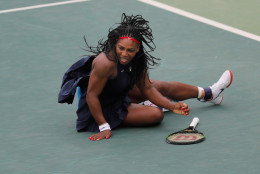 Serena Williams of the United States falls during the match against Australia's Daria Gavrilova in the women's tennis competition at the 2016 Summer Olympics in Rio de Janeiro, Brazil, Sunday, Aug. 7, 2016. (AP Photo/Vadim Ghirda)