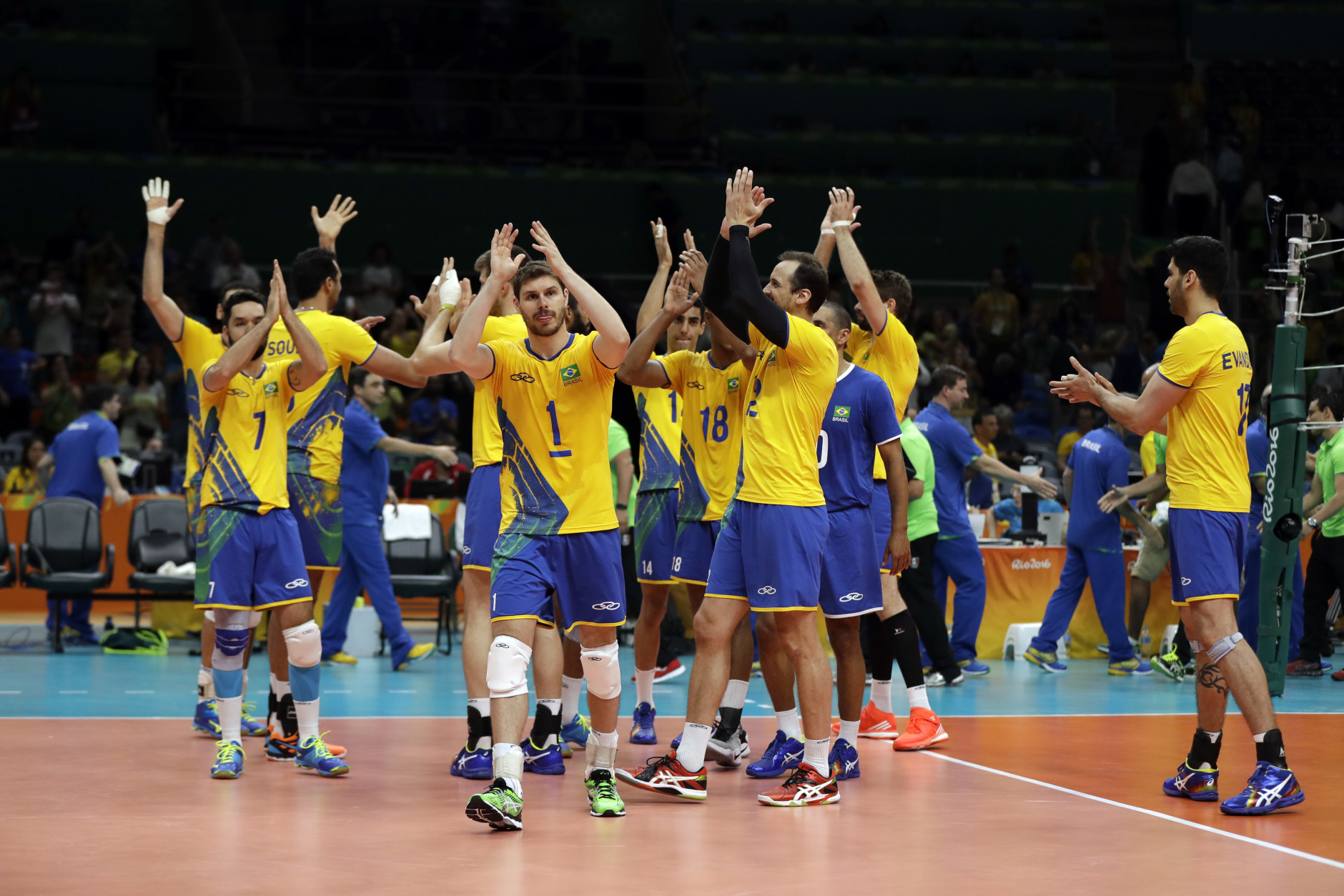 Members of team Brazil celebrate after defeating Mexico during a men's preliminary volleyball match at the 2016 Summer Olympics in Rio de Janeiro, Brazil, Sunday, Aug. 7, 2016. (AP Photo/Matt Rourke)