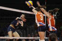 China's Zhang Changning, left, hits the ball past Netherlands' Yvon Belien (3) and Anne Buijs, right, during a women's preliminary volleyball match at the 2016 Summer Olympics in Rio de Janeiro, Brazil, Saturday, Aug. 6, 2016. (AP Photo/Matt Rourke)