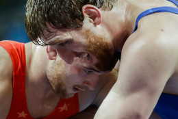 United States' Kyle Frederick Snyder, red, competes against Romania's Albert Saritov, blue, during the men's 97-kg freestyle wrestling competition at the 2016 Summer Olympics in Rio de Janeiro, Brazil, Sunday, Aug. 21, 2016. (AP Photo/Markus Schreiber)