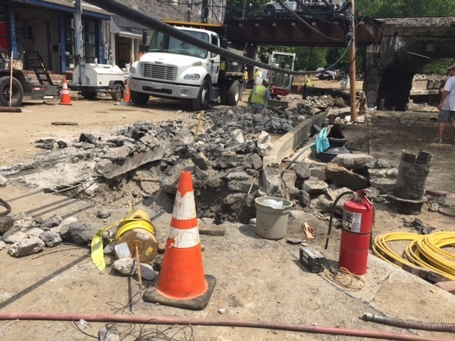 Main Street in historic Ellicott City, Maryland is seen Monday, Aug. 1, 2016, after the city was ravaged by floodwaters Saturday night, killing two people and causing devastating damage to homes and businesses, officials said. Virtually every home or business along Main Street sustained at least some damage, and the cost of repairs could reach the hundreds of millions of dollars, said Howard County Executive Allan Kittleman. (AP Photo/Juliet Linderman)