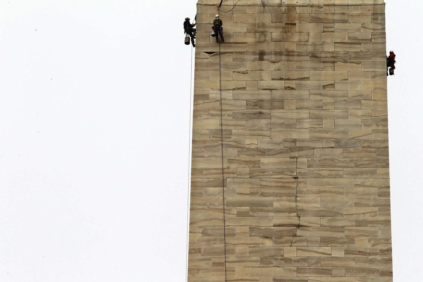 WASHINGTON, DC - OCTOBER 03:  Difficult Access Team (DAT) engineers with Wiss, Janney, Elstner Associates examine stones of the Washington Monument for cracks October 3, 2011 in Washington, DC. The DAT team continued the inspection of the monument to check for more damage caused by the 5.8-magnitude earthquake on August 23, 2011.  (Photo by Alex Wong/Getty Images)
