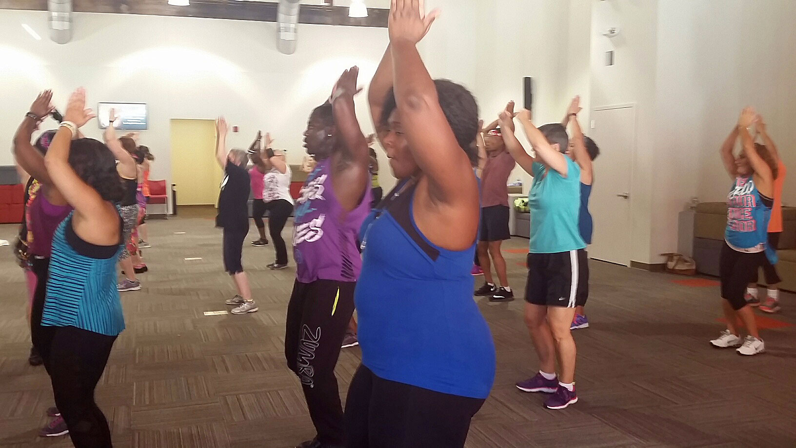 Participants sweat it out during a two-hour Zumbathon fundraiser in Takoma Park, Md. on Sunday, Aug. 28, 2016. (WTOP/Kathy Stewart)