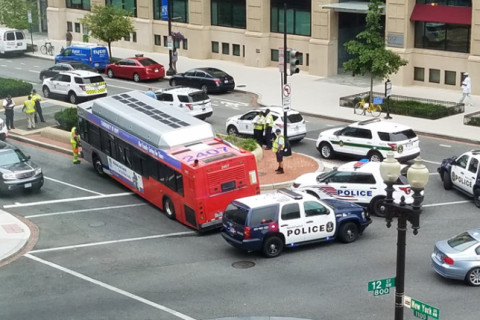 Bus ends up on DC curb after medical emergency