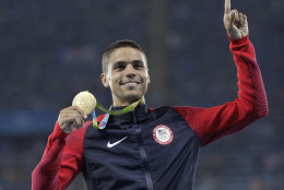 United States' Matthew Centrowitz celebrates on the podium after winning the men's 1500-meter final during athletics competitions at the Summer Olympics inside Olympic stadium in Rio de Janeiro, Brazil, Saturday, Aug. 20, 2016. (AP Photo/Jae C. Hong)