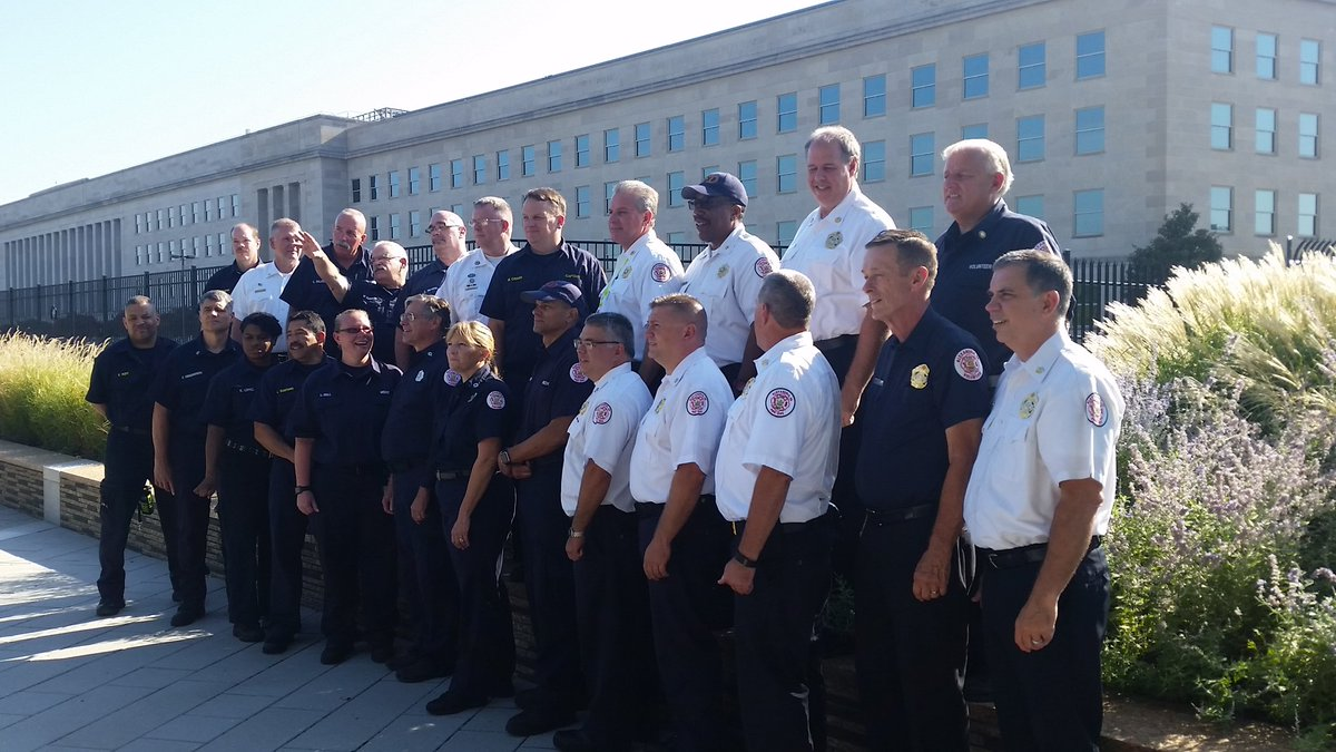 Firefighters and volunteers who responded to the 9/11 Pentagon attack gathered for a 15-year anniversary photo Saturday, August 27, 2016. (WTOP/Kathy Stewart)