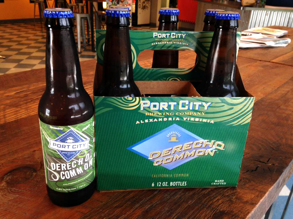 In this file photo, a six pack of Port City Brewing's limited release beer Derecho sits on the bar at the Alexandria brewery. The business will expand into new markets and will more than double its production to meet the growing demand with the help of state and local grants. (WTOP File Photo/Michelle Basch)