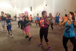 The goal of this Zumbathon event was to raise funds for victims of an explosion at Flower Branch Apartments in Silver Spring, Md. (WTOP/Kathy Stewart)