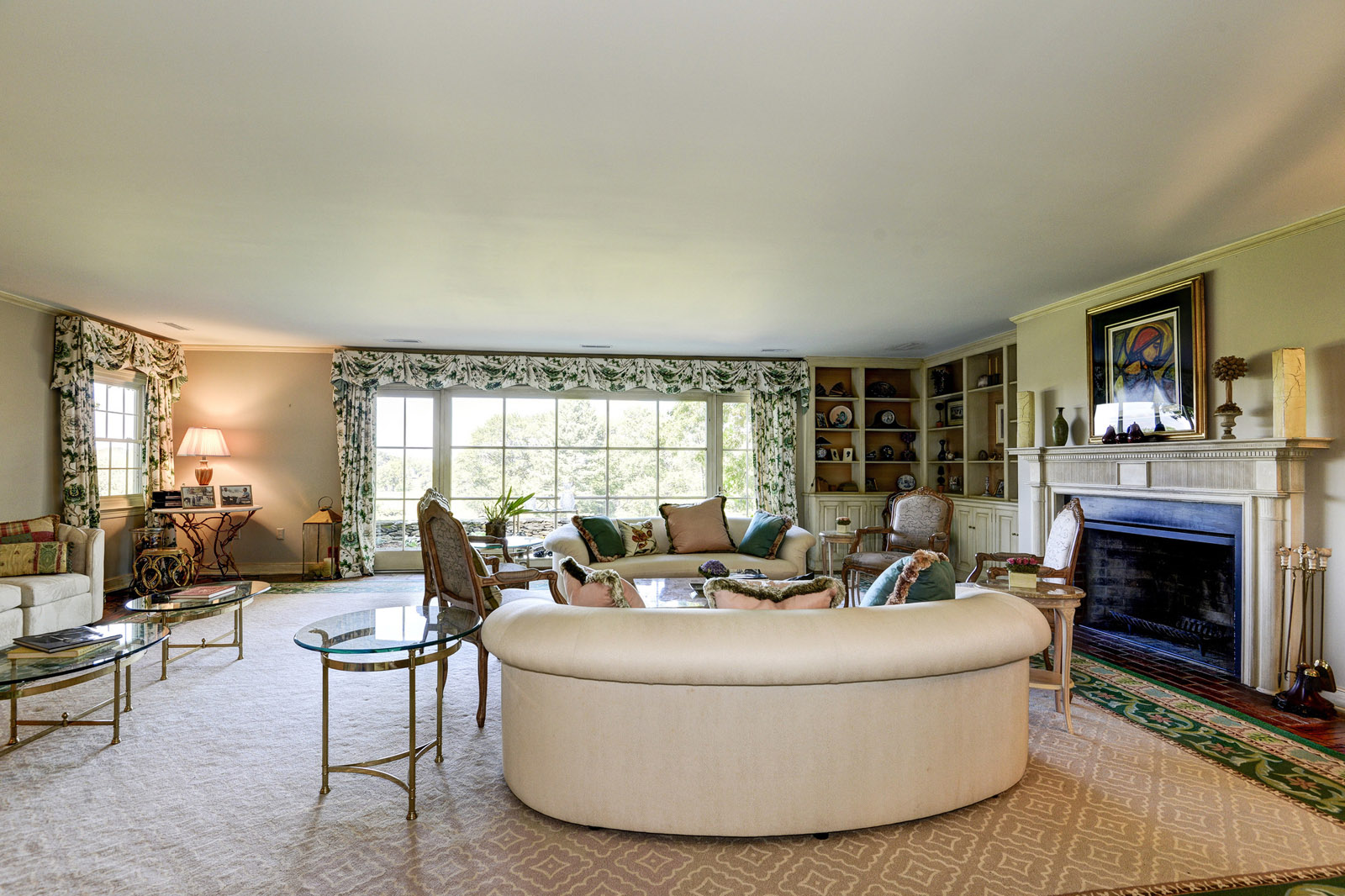This photo provided by Thomas and Talbot Real Estate shows the living inside the 5,000-square-foot house at the Wexford Estate, the 1963 retreat that Jacqueline Kennedy Onassis designed for her family. The home is nestled on more than 166 acres in Virginia's hunt country.  (Courtesy Thomas and Talbot Real Estate and Mona Botwick Photography)