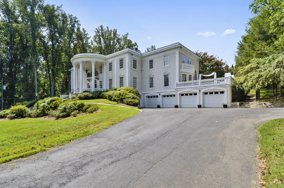 """An exterior view of the """"White House on Georgetown Pike,"""" a McLean,Virginia, mansion going up for auction next month. (Photo courtesy Tranzon Fox)"""