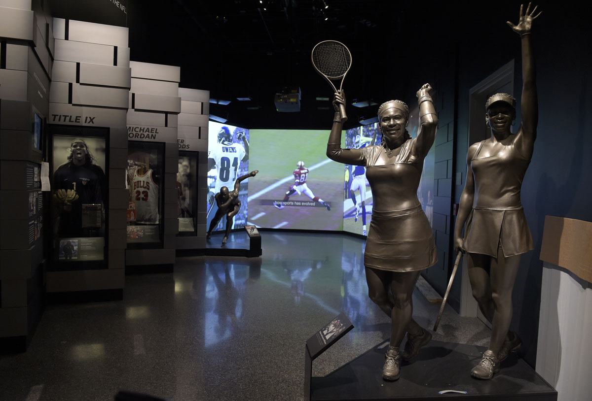 A statue of the Williams sisters, Serena and Venus, is part of the sports exhibit at the National Museum of African American History and Culture in Washington, Wednesday, Sept. 14, 2016. (AP Photo/Susan Walsh)