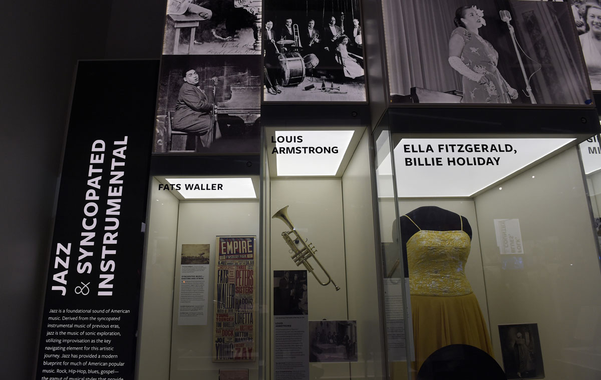 Louis Armstrong's trumpet, and other artifacts are displayed at the National Museum of African American History and Culture in Washington, Wednesday, Sept. 14, 2016, during a press preview. (AP Photo/Susan Walsh)