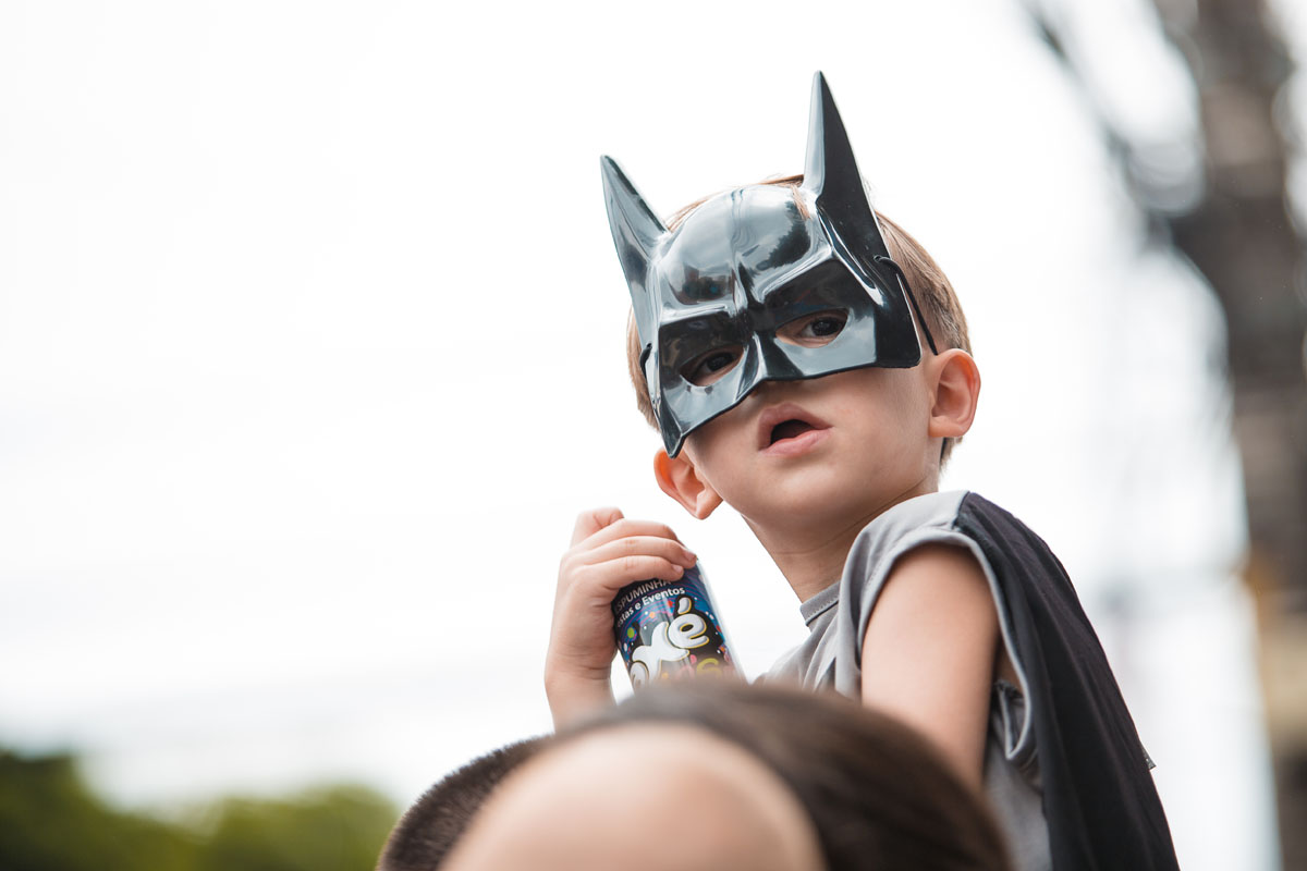 $. Batman characters. A child with batman costume has fun during the street carnival. (Mauricio Santana/Getty Images)