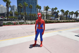 10. Spiderman costume. A fan dressed as Spiderman practices his moves outside of the convention center on day 1 of the 2014 Comic-Con International Convention held Thursday, July 24, 2014 in San Diego. (Photo by Denis Poroy/Invision/AP)