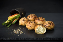 "December 15, 2015 - New York, NY : Bantam Bagels ""everybody's favorite"" bagel balls photographed with vegetables and sesame seeds, for use on product packaging."
