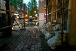 A business in Old Town Alexandria prepares for more flooding at about 7 a.m. Friday, Sept. 30, 2016. (WTOP/Dennis Foley)