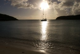 A lone sailboat rests in the waters of Saltpond Bay at St. John, U.S. Virgin Islands, Dec. 17, 2000. With a large portion of land and water protected within the boundaries of a national park, St. John remains perhaps the most pristine of the Virgin Islands. (AP Photo/ Tomas van Houtryve)