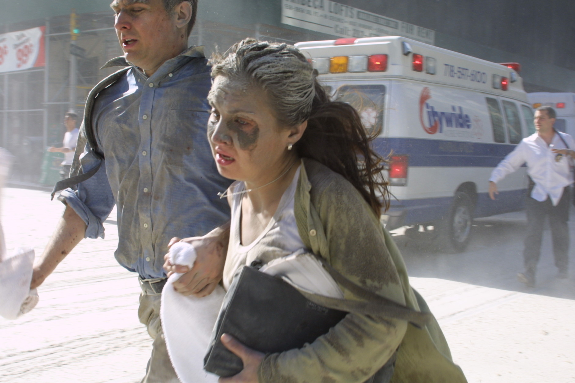 People flee the scene near New York's World Trade Center after terrorists crashed two planes into the towers on Tuesday, September 11, 2001. In a horrific sequence of destruction, terrorists hijacked two airliners and crashed them into the World Trade Center in a coordinated series of attacks that brought down the twin 110-story towers. (AP Photo/Diane Bondareff)