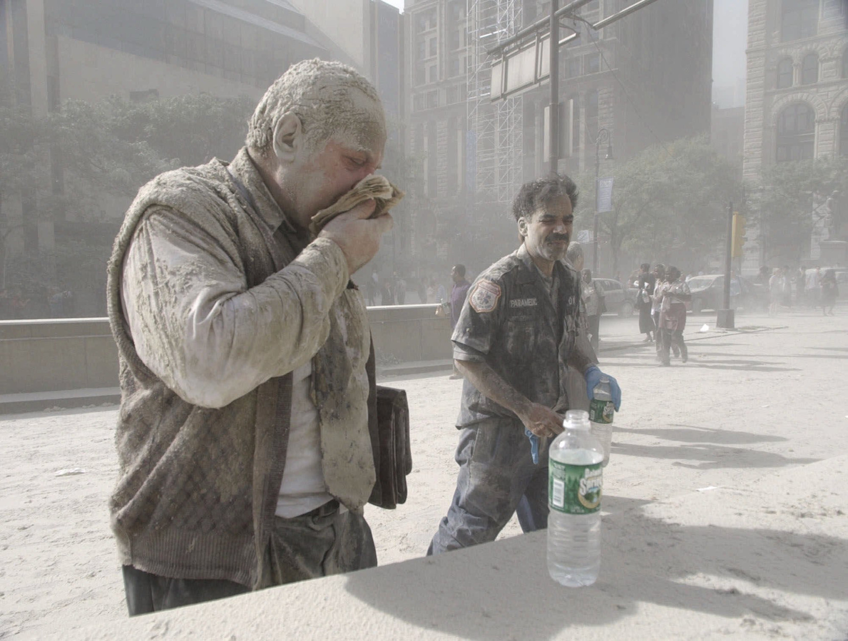 FILE - In this Sept. 11, 2001 file photo, a man wipes ash from his face after terrorists flew two airplanes into the World Trade Center towers, causing them to collapse. A federal health official is expected to announce in early June, 2012, whether people with cancer will be covered by an aid program for New Yorkers sickened by World Trade Center dust. An advisory committee recommended in March that the government open up the $4.3 billion program to people who developed cancers after being exposed to the toxic soot that fell on Manhattan when the towers collapsed. (AP Photo/Amy Sancetta, File)