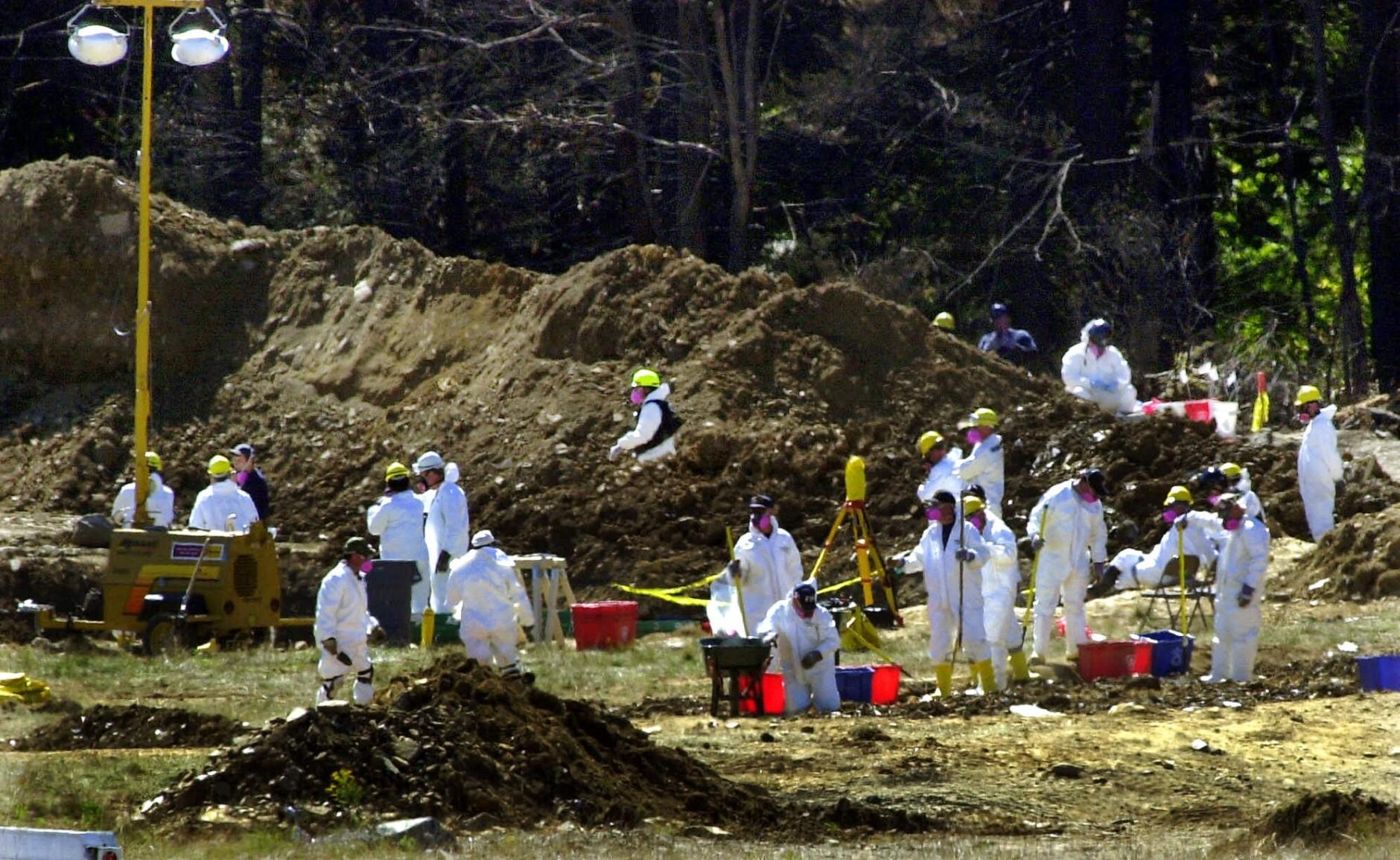 FBI investigators continue their excavation at the Shanksville, Pa., crash site of United Flight 93 on Sunday, Sept. 16, 2001. (AP Photo/Gene J. Puskar)