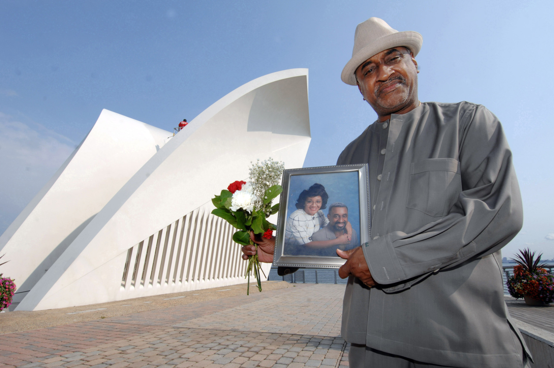 Joseph Jones, whose wife Felicia Dunn-Jones died of lung disease five months after inhaling toxic dust in the 9/11 terrorist attacks, poses with their portrait at the 9/11 Memorial on Staten Island, New York on Thursday, Sept. 6, 2007. Her name has been added to the list of victims of the Sept. 11, 2001 attacks on the World Trade Center. (AP Photo/Henny Ray Abrams)
