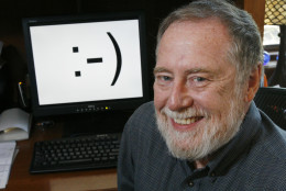 """Carnegie Mellon professor Scott E. Fahlman is shown in his home office on Monday, Sept. 17, 2007, in Pittsburgh. Twenty-five years ago, three keystrokes _ a colon followed by a hyphen and a parenthesis _ were first used as a horizontal """"smiley face"""" in a computer message by Fahlman, the university said.  Fahlman posted the emoticon in a message to an online electronic bulletin board at 11:44 a.m. on Sept. 19, 1982. (AP Photo/Gene J. Puskar)"""