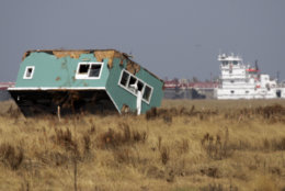 A house sits upside down in a field Friday, Sept. 26, 2008 in Crystal Beach, Texas, nearly two weeks after Hurricane Ike struck the Texas Gulf coast. (AP Photo/Pat Sullivan)