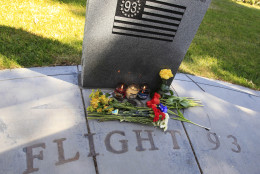 Flowers are left and candles lit at a memorial for victims of flight 93 in Union City, Calif., Monday, May 2, 2011 after Osama bin Laden was killed. Flight 93 was hijacked by four al-Qaida terrorists and crashed in to a field as part of the Sept. 11 attacks. (AP Photo/Paul Sakuma)