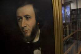 In this Friday, Feb. 10, 2012 photo, a 19th century painting of poet Robert Browning is on display at the Margaret Clapp Library on the campus of Wellesley College, in Wellesley, Mass. Beginning Valentine's Day Tuesday, Feb. 14, 2012, the famous love letters of Elizabeth Barrett and Robert Browning will be available on line as part of a digitization collaboration between Wellesley and Baylor University in Texas. (AP Photo/Steven Senne)
