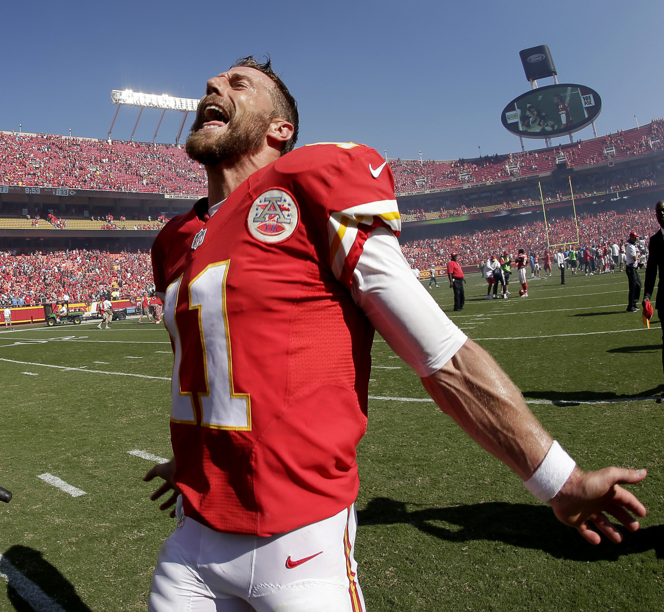 Kansas City Chiefs quarterback Alex Smith celebrates after an NFL football game against the San Diego Chargers Sunday, Sept. 11, 2016, in Kansas City, Mo. Kansas City won 33-27 in overtime. (AP Photo/Charlie Riedel)